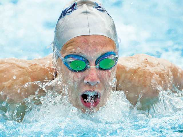 Prep swimming: 'Cats, Cents split meet