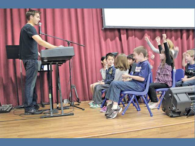 Students participate in a singing during an after-school enrichment class at Club FAME held at Higher Vision Church.