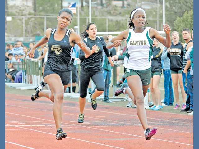 Canyon High's Erica Anunwah, right, wins the 100-meter dash against Imani Dixon, left, of Golden Valley at Canyon High on Thursday. The Canyon girls won 85-51.