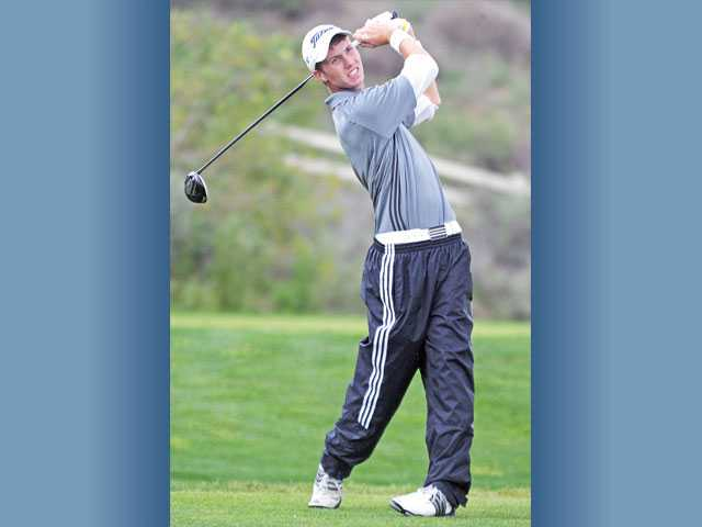 Saugus High golfer Zack Leonard watches his shot off the seventh tee on Thursday at TPC Valencia.