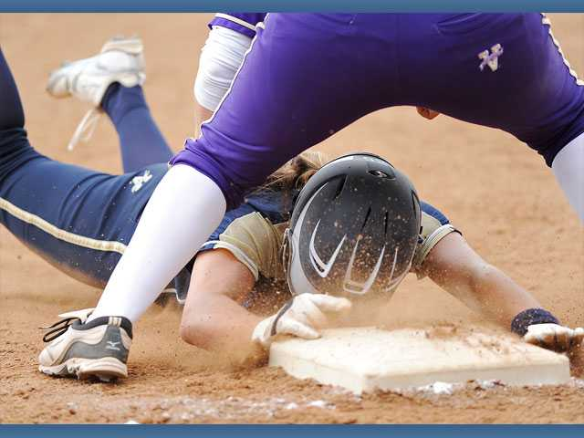 West Ranch's Janelle Lindvall is tagged out by Valencia's Nicole Joseph at third on Thursday at Valencia High.
