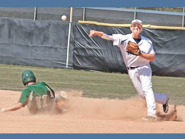 After tagging out Canyon shortstop Kevin Morrice, left, Saugus shortstop Dylan Freyre throws to first base during the Centurions' game with Canyon on Friday at Saugus High School.