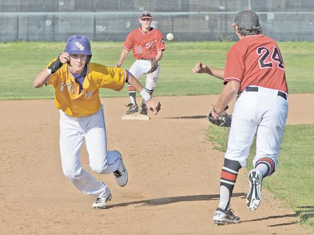 Valencia baserunner Chris McCready, left, breaks for third as Hart's Joseph Bilbo (24) throws to Cody Miller on Friday at Hart High.