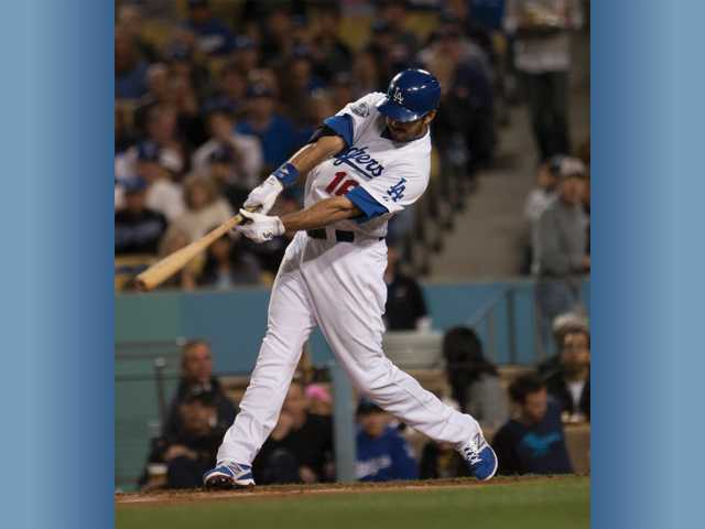 Dodgers outfielder Andre Ethier hits a single in the fourth inning against the Washington Nationals at Dodger Stadium in Los Angeles. The Dodgers won 3-2.