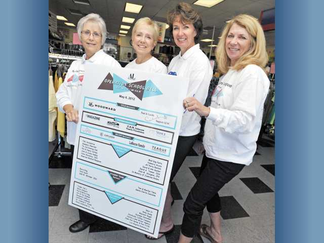 From left, Fran Whitney, Joanie Smelser, Durinda Evanoff and Holly Gravett hold a Walk poster.
