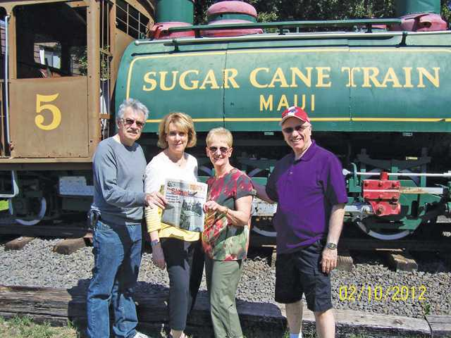 Ed Docks, Linda Docks, Rita Kass and Bob Kass took The Signal to the Sugar Cane Train in Maui recently.