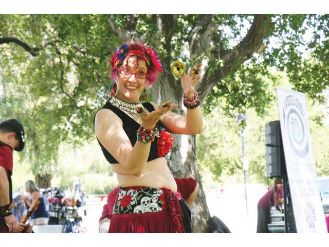 DeBra takes part in an American tribal-style bellydancing performance with Holly Schroeder