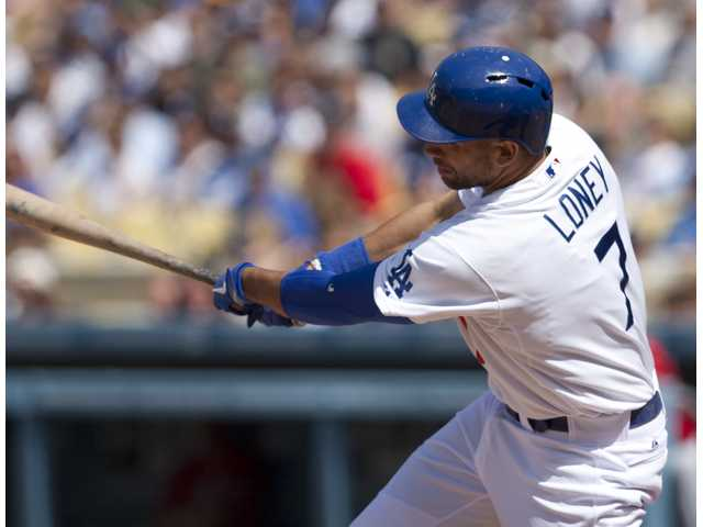 Dodgers first baseman James Loney hits a two-RBI single during the sixth inning on Sunday in Los Angeles.