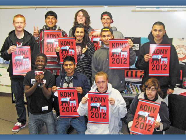 Bowman High students pose with Kony 2012 posters.