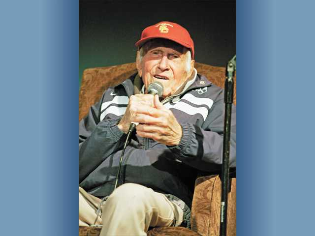 Olympian, prisoner of war and World War II veteran Louis Zamperini address an audience of 700 at Trinity Classical Academy recently.