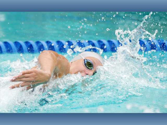Saugus High freshman swimmer Abbey Weitzeil swims the 200-yard freestyle at the Foothill League prelims at the Santa Clarita Aquatic Center on Tuesday. Weitzeil broke the league record with her time of 1:49.54, besting the 1:52.94 set in 2011 by Valencia's Micaela Velasquez.