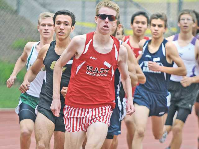 Hart High runner Austin O'Neil, center, leads the pack of runners in the 1600 at College of the Canyons on Tuesday.