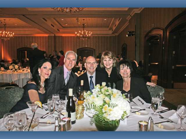 Left to right, Shelley and G. Marshall Hann join Joel Cox, Marjanne Priest and Judy Cox at the SCVi Charter School fundraiser. The event was held to benefit technology resources at the charter school.