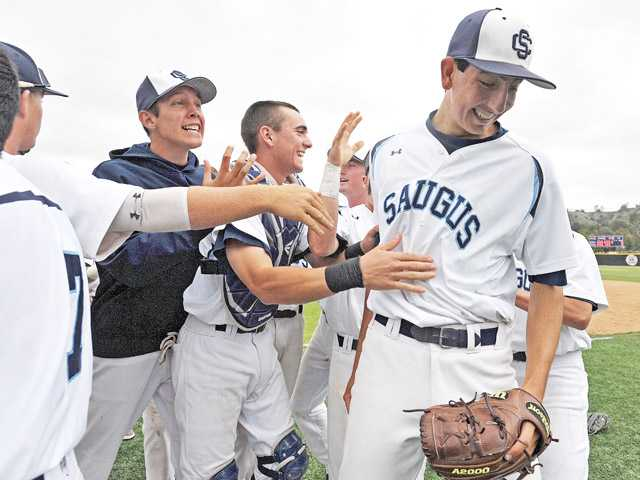 Teammates congratulate Saugus pitcher Justin Donatella, right, after the Centurions' win over Valencia on Wednesday at Saugus High School.