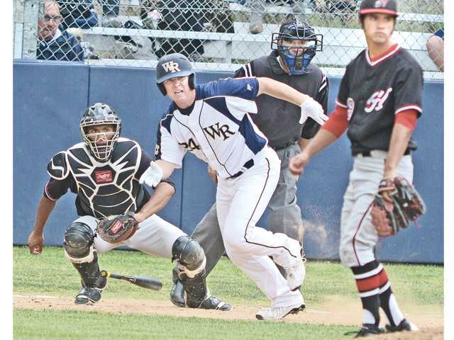 Hart High catcher Baggio Saldivar, left, and Hart pitcher Jesse Posey, right, watch a base hit by West Ranch's Tyler Woldanski (24) at West Ranch High on Wednesday.