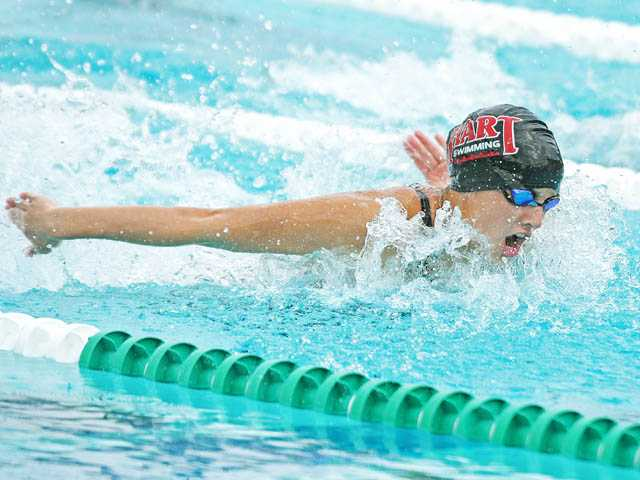 Hart High swimmer Mik Ranslem swims the butterfly stroke in the 200-yard individual medley in the Foothill League finals on Thursday at the Santa Clarita Aquatic Center.