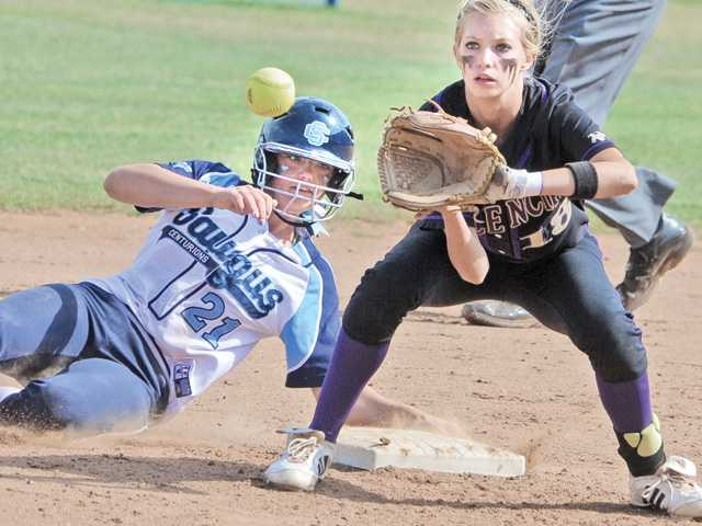 Saugus' Alanna Layton (21) slides into second base in front of Valencia's Emma Stanley on Thursday at Saugus High.