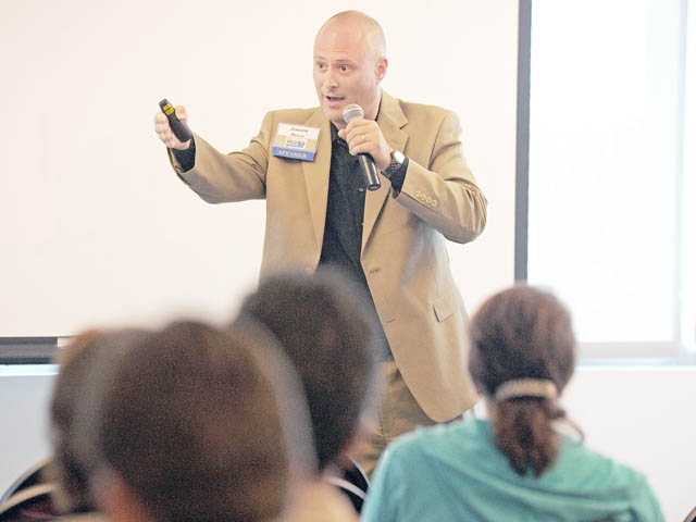 Jason Price speaks at the fifth annual Dream & Discover Conference, which was held in the University Center at College of the Canyons on Thursday.