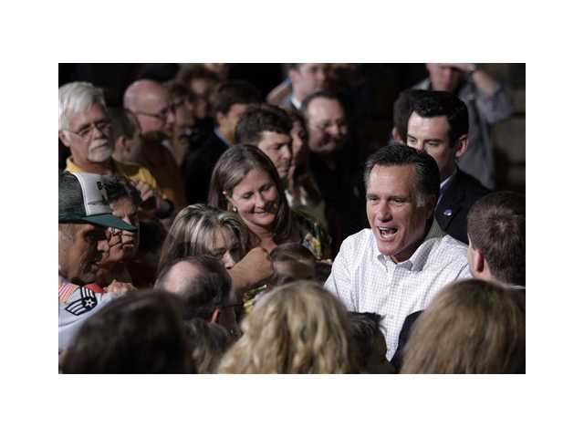Republican presidential candidate, former Massachusetts Gov. Mitt Romney greets supporters at a campaign stop in Pittsburgh, Pa., Friday