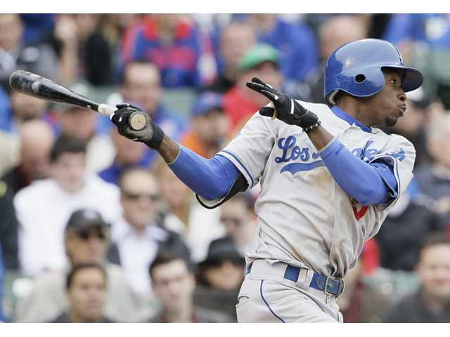 Los Angeles Dodgers' Dee Gordon hits a single against the Chicago Cubs during the ninth inning of a baseball game in Chicago, Saturday, May 5, 2012. (AP Photo/Nam Y. Huh)