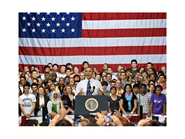 President Barack Obama speaks to students and parents at Washington-Lee High School in Arlington, Va., Friday, May 4, 2012, about his efforts to prevent interest rates from doubling on federal student loans.