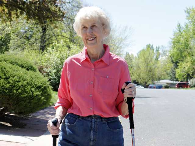 Elaine Vlieger, 79, walks near her home near Denver, Colo.