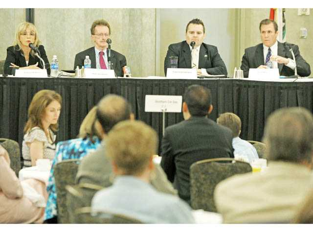 From left, state Assembly candidates Patricia McKeon, Paul Strickland, Edward Headington and Scott Wilk speak in a forum at the Hyatt Regency Valencia on Monday.