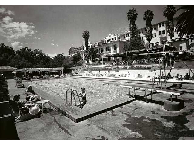 In this 1938 image released by Beverly Hills Collection, pool at The Beverly Hills Hotel is seen upon completion. The Beverly Hills Hotel is celebrating its 100th Anniversary in May.
