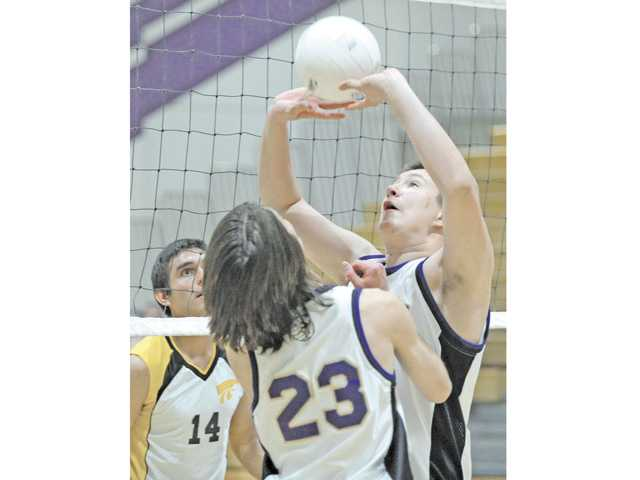 Valencia's Kyle Grant, right, sets the ball for teammate Spencer Kershner (23) as Pete Knight's Victor Jacobo prepares to block during the first round of the CIF-Southern Section Division II playoffs on Tuesday at Valencia High School.