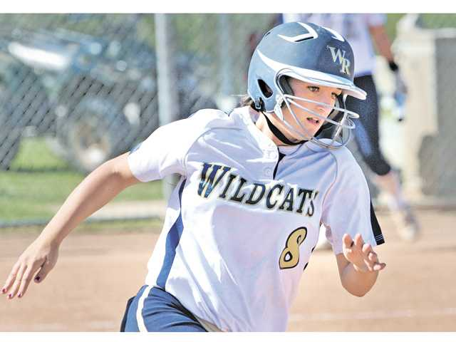 West Ranch's Lauren Lindvall rounds third base after hitting a home run against Hart during the third inning on Tuesday at West Ranch High School.