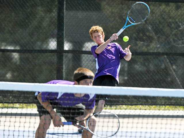 The Valencia No. 1 doubles team of David Myers, left, and Cameron Braun return a serve against South Hills on Wednesday at Valencia High. The Vikings won 15-3.