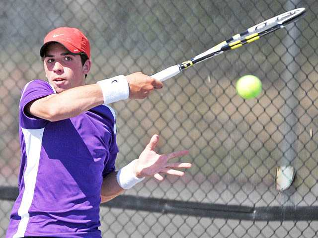 Valencia's No. 3 singles player Chris Pope returns a shot in a CIF-Southern Section Division II playoff match against South Hills on Wednesday at Valencia High. The Vikings won 15-3 to advance to the second round.