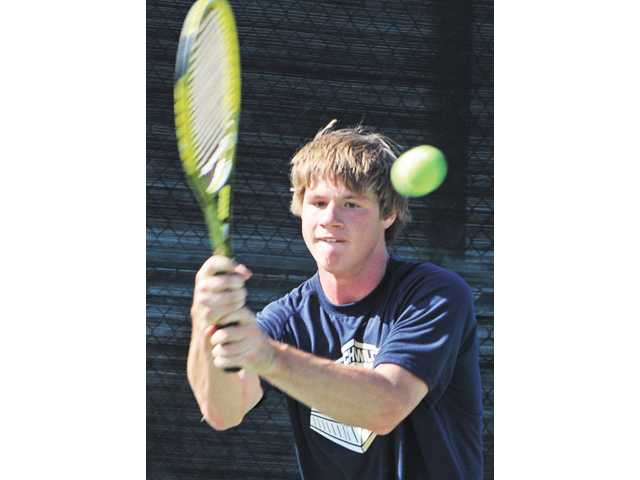 West Ranch tennis player Christian Cranert competes with San Luis Obispo during a CIF-Southern Section Division II first round matchup on Wednesday at West Ranch High. Cranert won two sets for the Wildcats.
