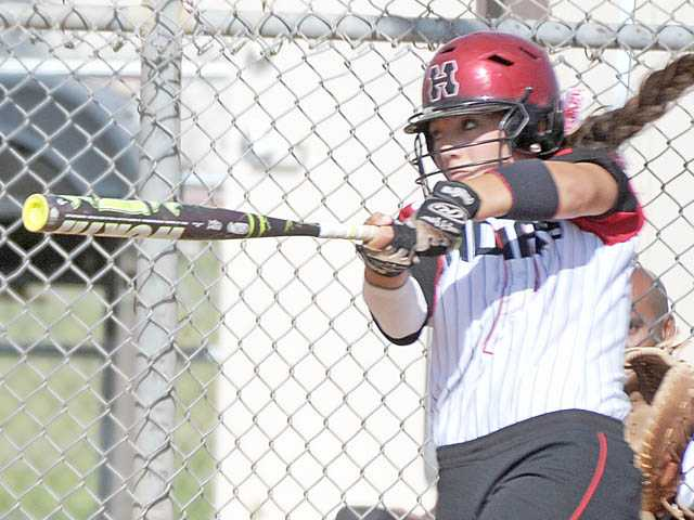 Hart's Paxton Provost belts a solo home run, her third of the game, during the fifth inning against Canyon on Thursday at Canyon High School. Hart won 10-4.