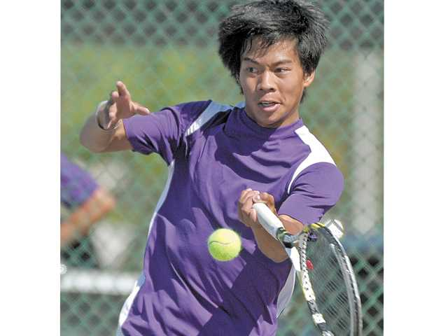Valencia No. 1 singles player J.R. Macalutas returns a shot in a CIF-Southern Section Division II playoff match against South Hills on Wednesday at Valencia High.