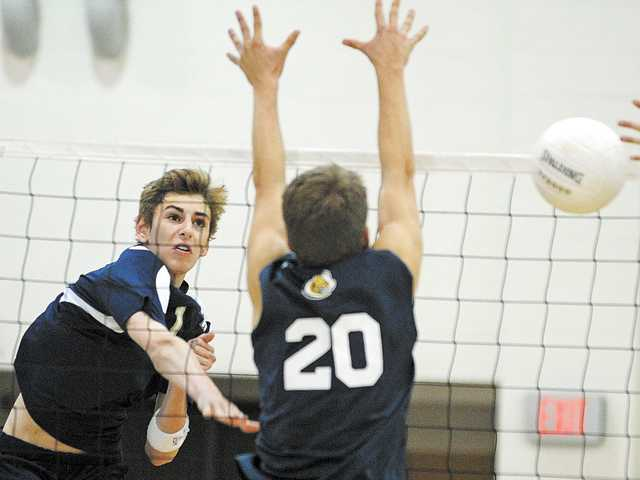 West Ranch outside hitter Dalton Peck (1) attacks past San Juan Hills' Reed Wilson (20) on Thursday night at West Ranch High.