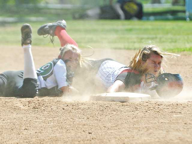 Hart's Tracy Chandless arrives safe at second base past Canyon shortstop Tiffany Dyson, in the third inning on Thursday at Canyon High.