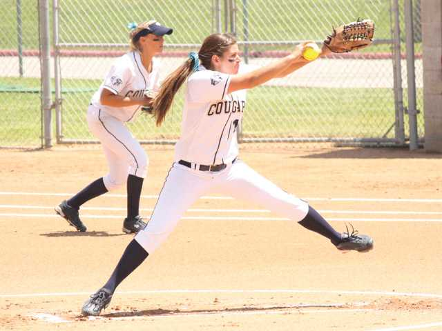 College of the Canyons pitcher Kimmie Lockhart delivers against Southwestern College during Friday's California Community College Athletic Association Super Regional game at COC while first baseman Shay Romero looks on.