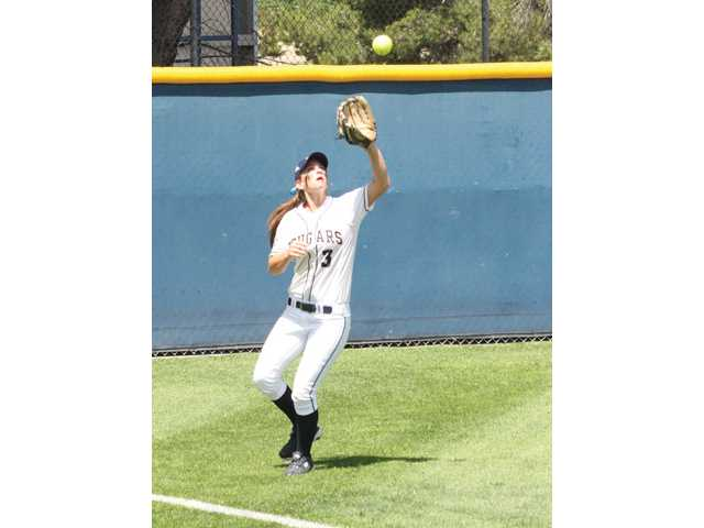 College of the Canyons sophomore Caitlyn Zimmerman gets under a fly ball in a game against Southwestern College on Friday at COC. Southwestern won 10-7.
