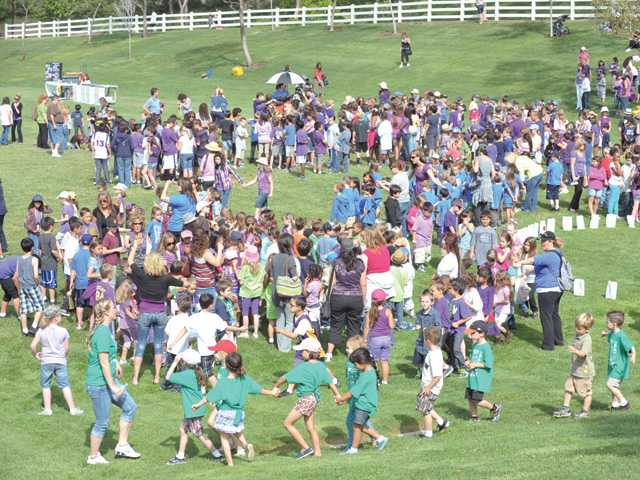 Approximately 1,000 kindergarten-through-sixth-grade students from North Park Elementary School gather at Chesebrough Park in Santa Clarita, as they participate in the inaugural American Cancer Society Relay Recess event on Friday.
