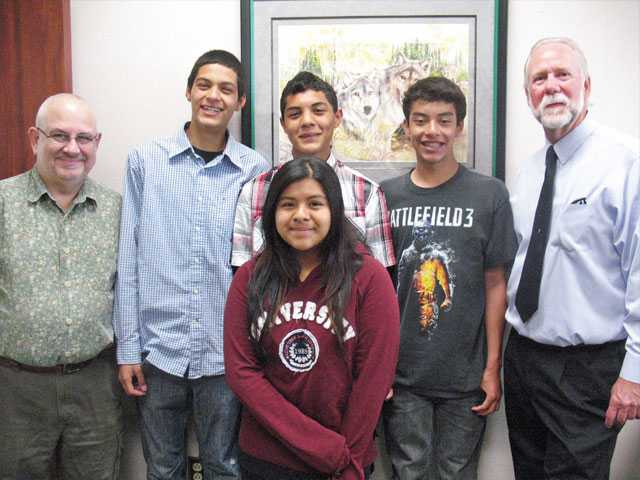 From left, La Mesa Junior High School business teacher Geoffrey Aronsky, students Alejandro Hernandez and Christian Saucedo Rodriguez, Principal Pete Fries and student Marisela Sanchez.