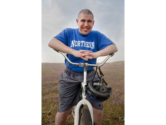 In this March 2011 photo provided by Jeff Martin, Ian Wells sits on a bicycle in North Hanover, N.J. Wells, 21, of Allentown, N.J., has autism and has had trouble finding paid employment.