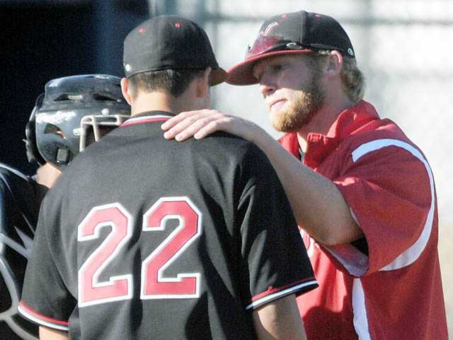 Hart pitching coach Kyle Boggio, right, left the team recently to pitch for the San Angelo Colts. The 2003 Hart grad simply will not give up his dream of making it to Major League Baseball.