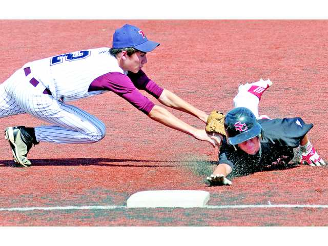 Santa Clarita Christian's Chad Latch beats the tag by Trinity second baseman Caleb Wilson during the CIF-Southern Section Division VII wild-card round on Tuesday at The Master's College.