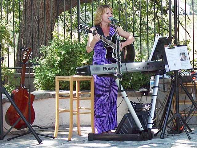 Singer Melissa Kaye entertains during Pop-a-cork for a Cure.