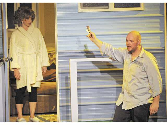 "Norbert (Jeremiah Lowder) tries to convince his agoraphobic wife Jeannie (Kristen Heitman) to step out of their trailer in ""The Great American Trailer Park Musical,"" which continues at the REP through June 16."