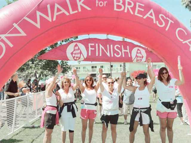 Alison Lindemann, third from right, celebrates her participation in the Avon Walk for Breast Cancer. Lindemann and five friends raised more than $12,000 for the walk.