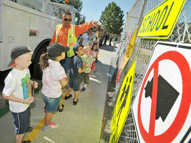 Louie Aguilar, of the city of Santa Clarita's Public Works Department, describes various street signs to students. Santa Clarita Elementary hosts the annual event to introduce its students to public servants.