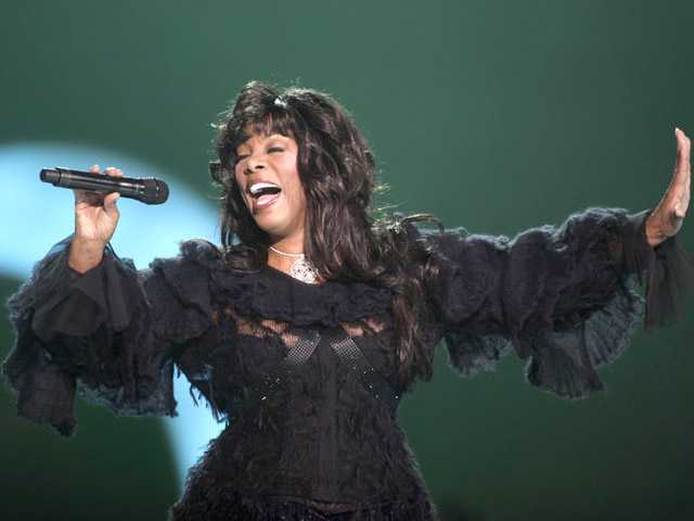 "In this Dec. 11, 2009, photo, Donna Summer performs at the conclusion of the Nobel Peace concert in Oslo, Norway. Summer, the Queen of Disco who ruled the dance floors with anthems like ""Last Dance,"" ""Love to Love You Baby"" and ""Bad Girl,"" has died."