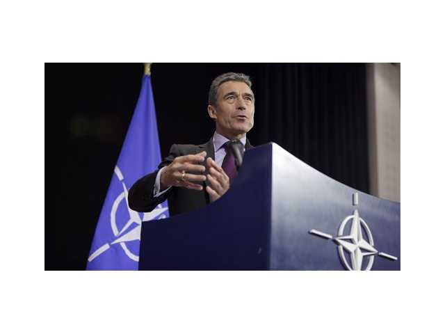 NATO Secretary General Anders Fogh Rasmussen addresses the media at NATO headquarters in Brussels on Wednesday